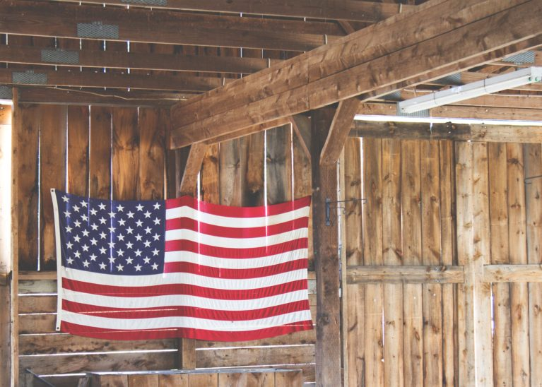 US Flag in a barn